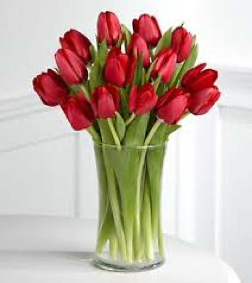 Nothing fancy, even a few tulips in a vase will maker her smile!