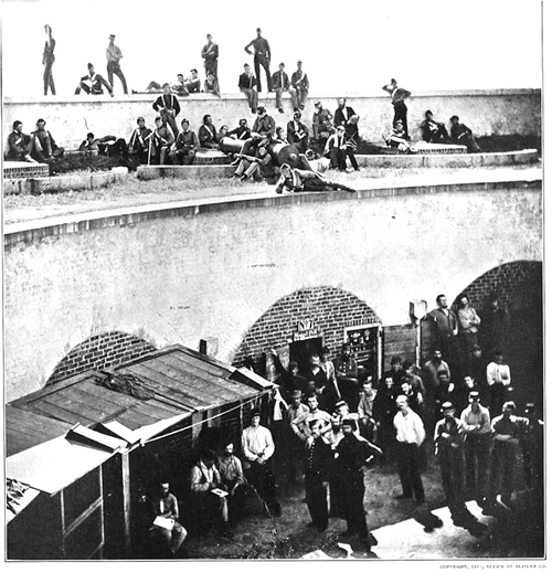 Union prisoners held in a fort; enemy guards occupy the ramparts above