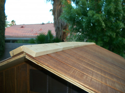 The trim boards were ten feet long.  The roof was several inches longer, so I added a short section of trim, one on each end.