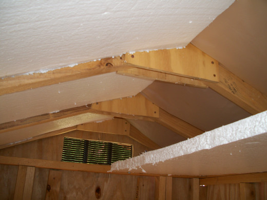 I measured between each set of rafters and cut the insulation to fit snugly.