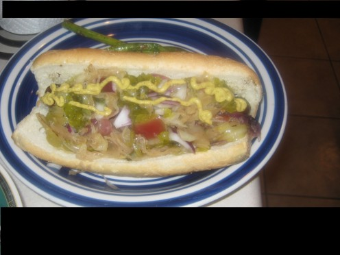 Grilled Sausage Topped With Cabbage, Apple, Bacon Sauerkraut on a bun. Prepared by Ray H.