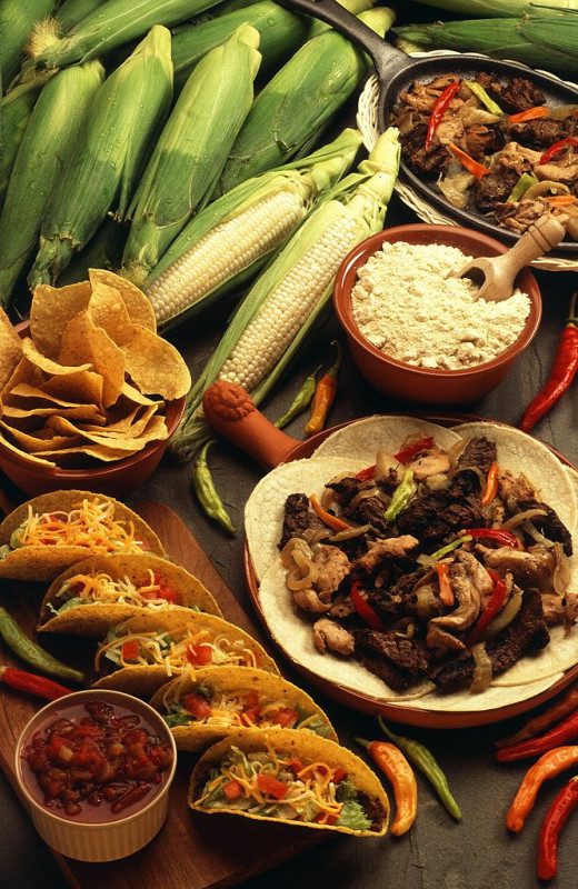 Typical Southwestern cuisine including tacos, corn, fajitas, salsa, cornmeal, chiles, and tortilla chips.