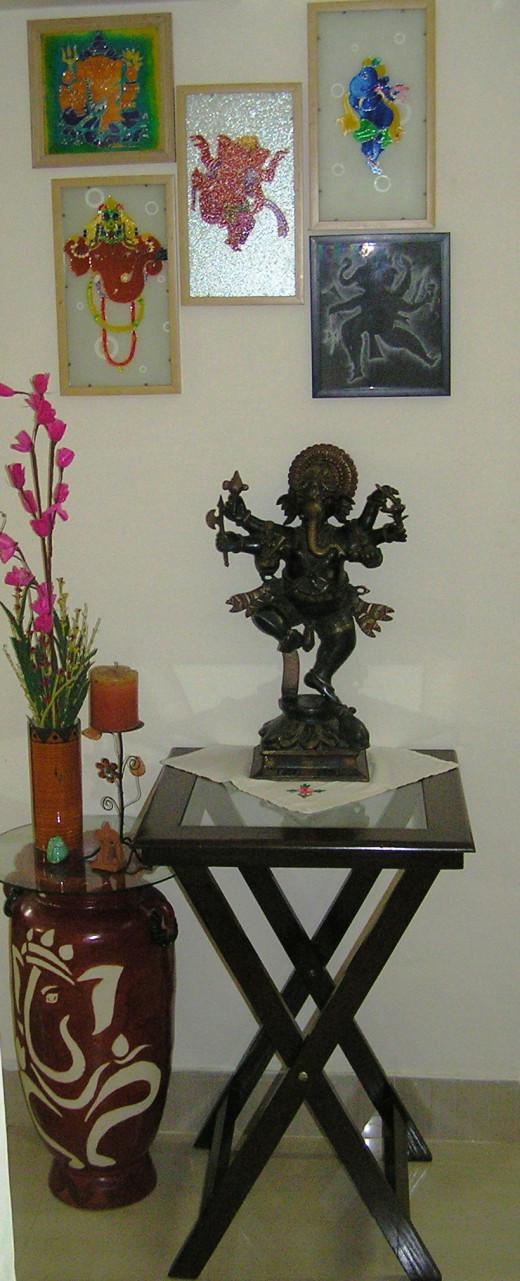 Ganesha idol, Ganesha motif on pot, paintings and small ganesha figurines