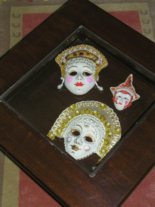 Russian masks enclosed in a glass top table