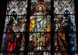 Stained glass window depicting Jesus Christ, Moses with the Ten Commandments and the Prophet Elijah. This window is located in the cathedral of Schwerin, Mecklenburg-Vorpommern, Germany.  Created before 1893.