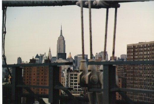 The Empire State Building from the Williamsburg Bridge, New York City.
