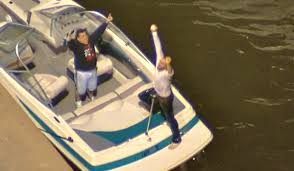 Fan catching a home run in the river.
