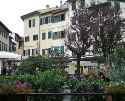 Enjoy a meal at an outdoor trattoria (c) A Harrison