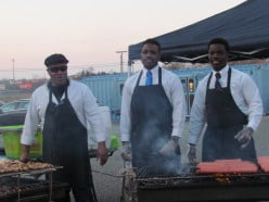 """Three chefs worked diligently on the grills barbequeing. A husband and wife team catered the event which was called, """"As You Wish Event Catering."""