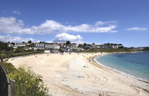 Looking at Gyllyngvase Beach from the south.  The Gylly Beach Cafe is in the centre of the picture with hotels behind and the beach can be seen extending towards Tunnel Beach on the centre right of the picture.