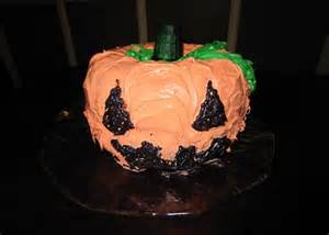 2 bundt cakes decorated to look like a jack-o-lantern
