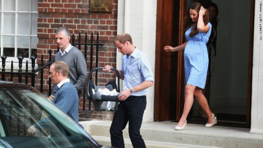 Notice that Prince William is carrying the carseat for Kate, who was still recovering at this time.