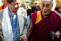 The Dalai Lama and Eckhart Tolle walking together.