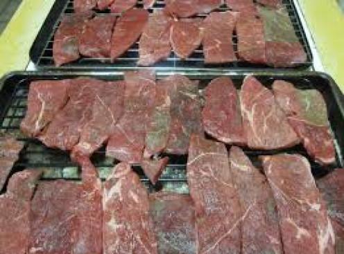 Laying Beef on Racks in Baking Pans