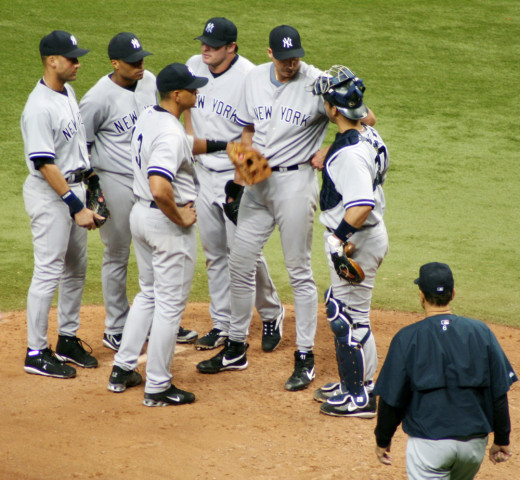 Cano, second from left, stands with Yankee stars Derek Jeter, Alex Rodriguez, Jason Giambi, Andy Pettitte and Jorge Posada during a 2006 game as manager Joe Torre approaches.