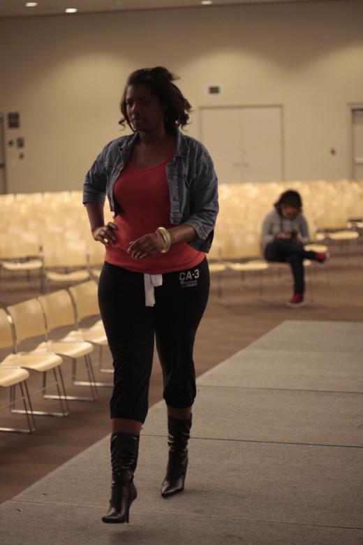 . . . A  Voluptuous Model Practices Her Walk . . .