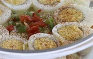 Deviled Eggs along the edge of the serving bowl.