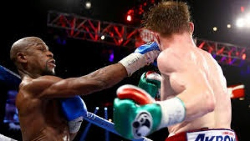 Floyd Mayweather, Jr., Seen here landing a right on Canelo Alvarez, is a master boxer to say the least. In 2014 Money beat Marcos Maidana twice.