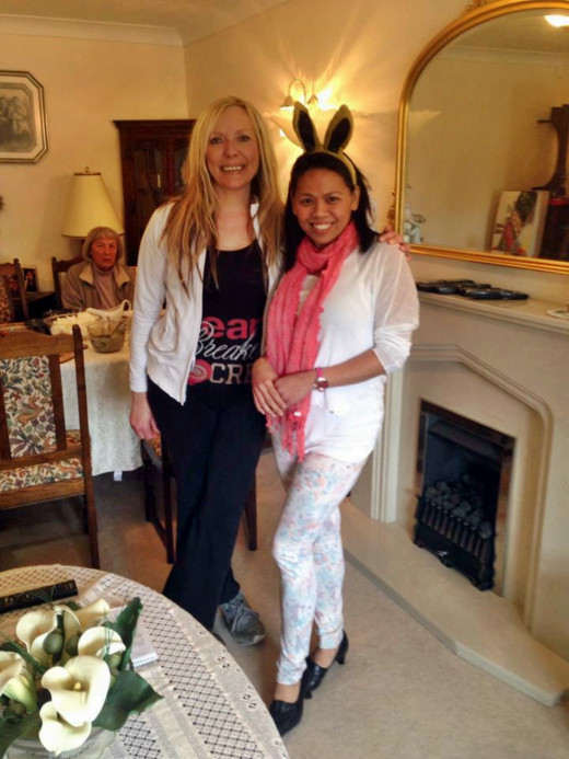 Me with Liza at our Easter meal in 2013 (with mum in the background, dining). I had started wearing stretch trousers and leggings to accommodate my weight gain.