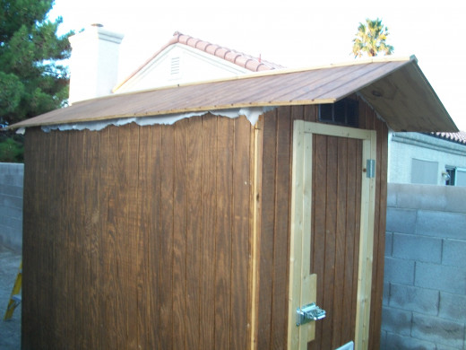 After T1-11 siding is installed but before corner trim is added and the roof plastic gets a final cut.