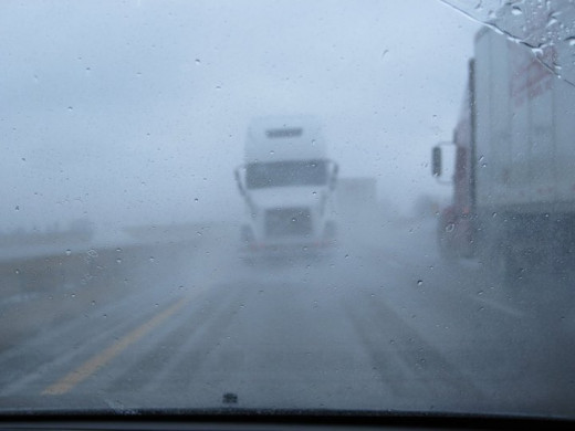 Visibility was poor, as you can see, when I saw THIS coming at me [I thought] down the highway. It was actually being towed by another truck. Way to scare drivers behind you half to death!