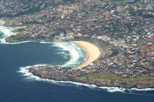 Bondi Beach is located on the Tasman Sea and is southeast of Sydney.