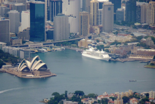The Sydney Opera House with a cruise ship in port nearby.