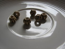 wooden beads are popular today and can be used in many methods of making jewelry