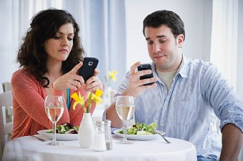 Talking with girlfriends, or another guy, while having dinner with her date