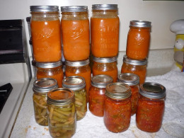 Various jars of food that I canned in my kitchen.