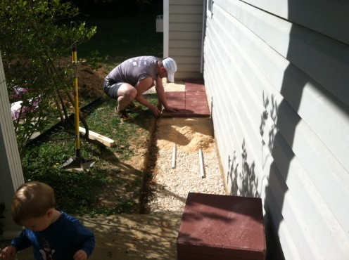 Leveling with PVC pipe and sand.
