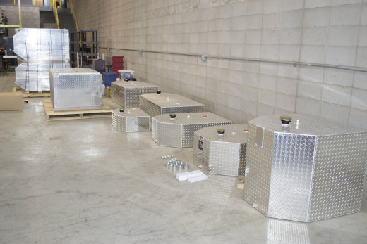 Different sized aluminum fuel tanks.