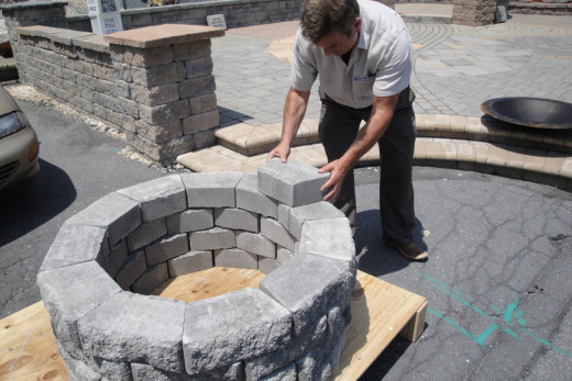 Adding a top layer with larger paver capstones.
