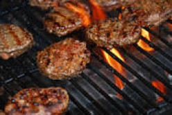 Delicious burgers on the grill. Careful! Do not be a glutton
