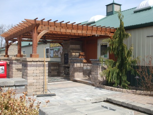 An immaculate, solid pergola with outdoor kitchen.