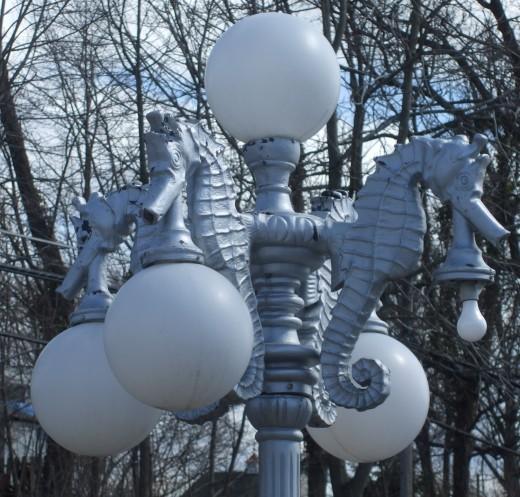 Seahorses on an elaborate lamppost.