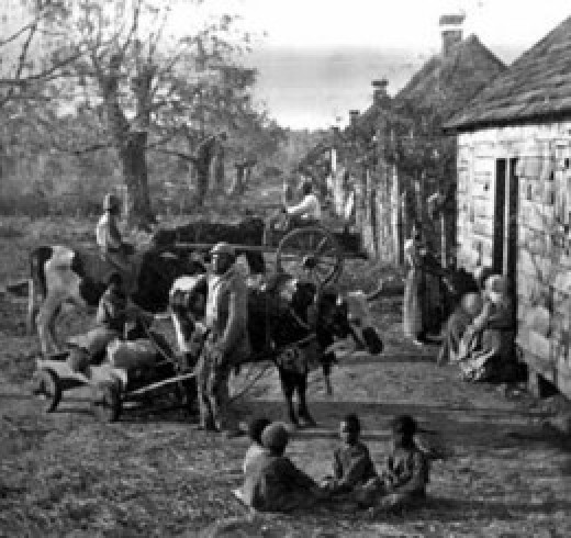 Slaves gather around their quarters at the end of the workday