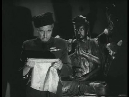 Colonel Mazovia stands before a Cambodian idol and reads a parchment  containing secret information about creating zombies