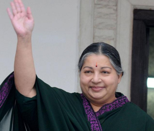 Jayalalitha is waving her hand to the AIADMK supporters.