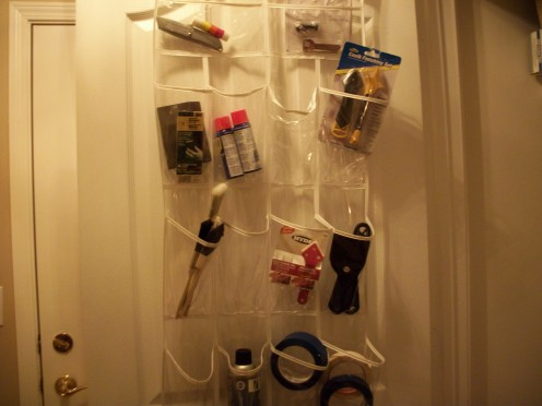 Hang this clear storage bag over the laundry room door or the foyer door for storage of tools, paint brushes, etc.