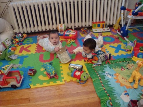 Toys left right out of reach to encourage movement while on tummy