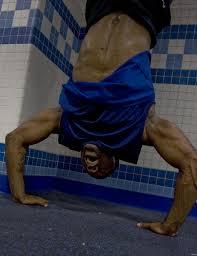 Handstand pushups build bigger shoulders!