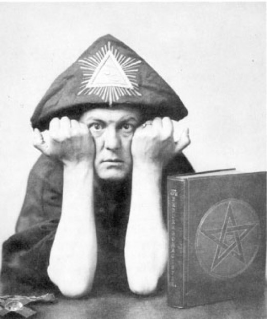 Crowley demonstrating Carlin's Law, the law introduced by George Carlin which states that any religion or cult, after a time, begins wearing their own  silly hats