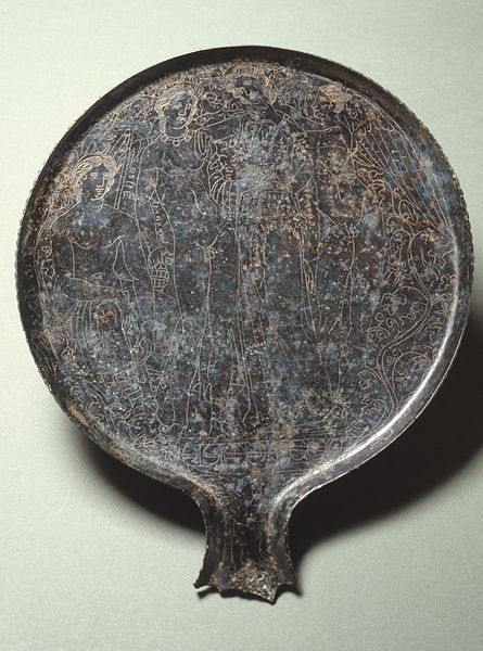 An ancient Etruscan mirror depicting Ariadne, Eros, Heracles, and Dionysus.