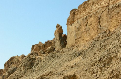 Lime stone (Brimstone, yellow colored) cliffs above the Qumran site. People beleive the portion of lime stone standing is the pillar of salt belongs to the wife of Lot.