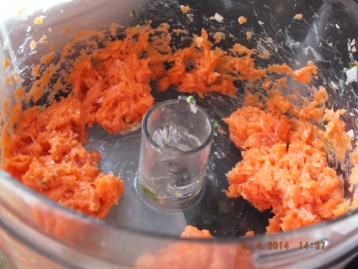 "You are going to want to work the fish in three batches. The first batch I am going to really whirl into a paste. This will be the only batch you will do this with. It will act as a ""glue"" for your salmon cakes."