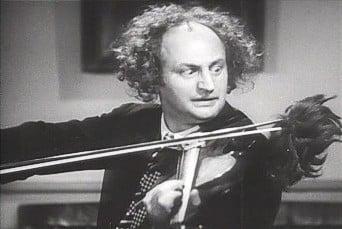 """Larry Fine from """"Disorder in the Court"""" (1936), in public domain}"""