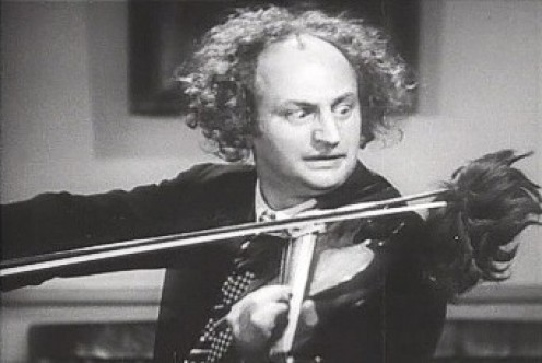 "Larry Fine from ""Disorder in the Court"" (1936), in public domain}"