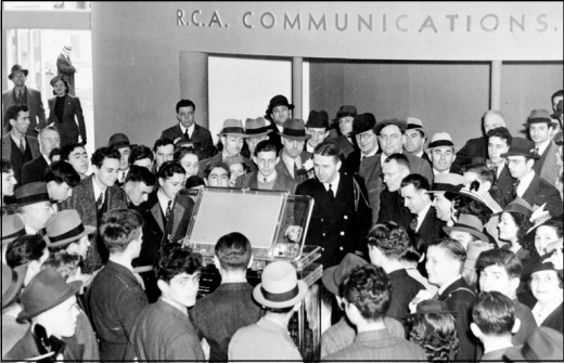 Crowds strain to get their first look at a television on display in the RCA Pavilion: