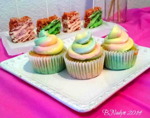 Bright or pastel-colored rainbow cupcakes will be a hit at a child's party.